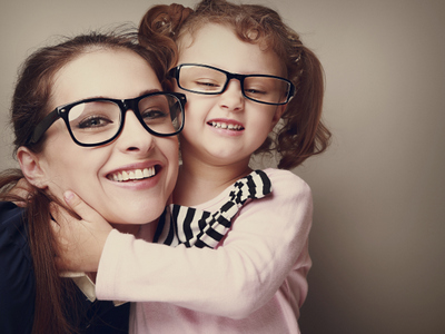 woman smiling with young girld